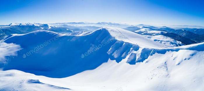 Wonderful giant snowdrifts on the hills