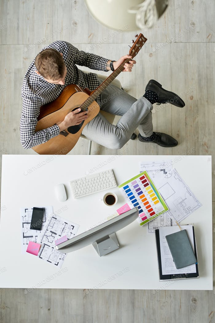 Young Architect Playing Guitar