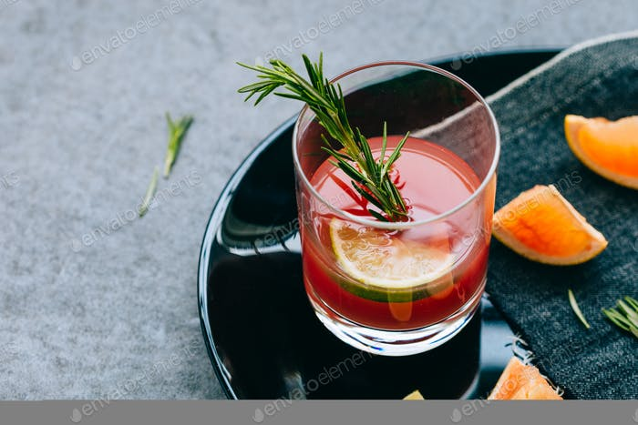 Cocktail in Glass on Gray Table