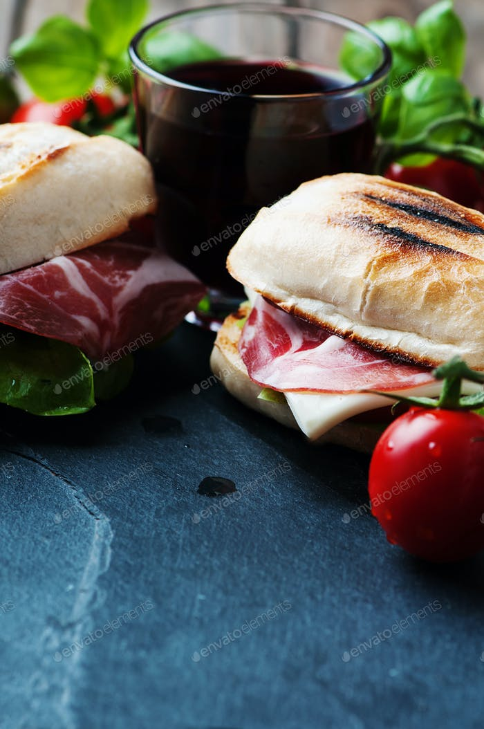 Sandwich with cheese, ham and vegetables