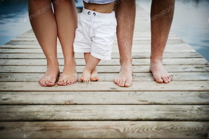 Family feet on pier