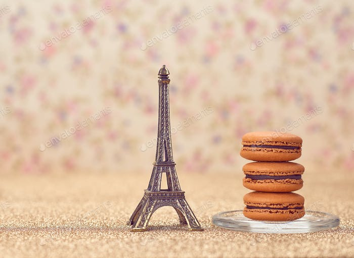 Macarons french dessert. Eiffel Tower on gold