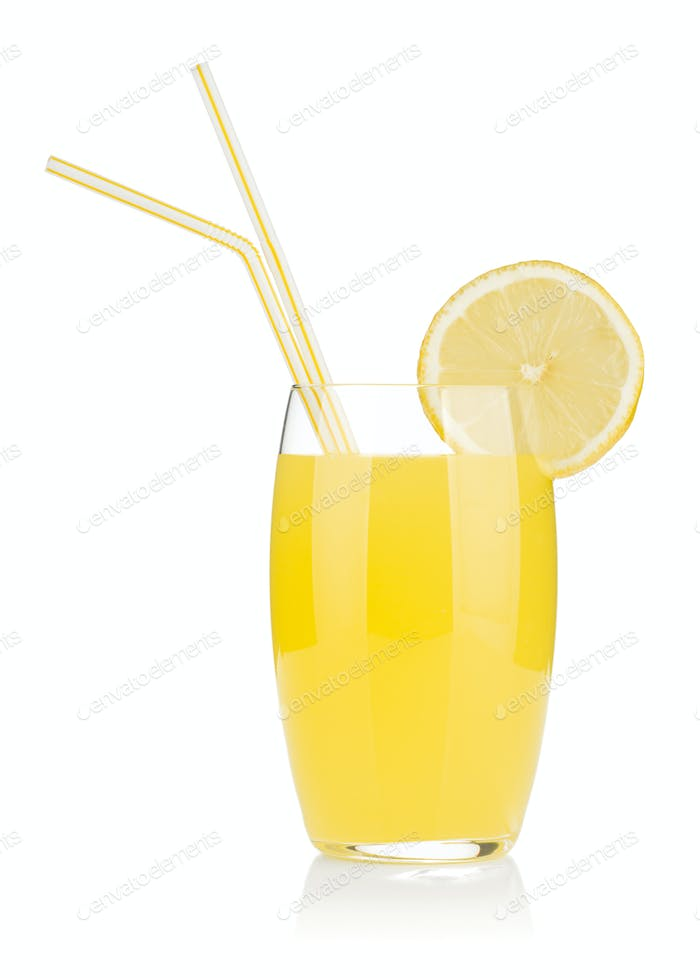 Lemon juice glass and two drinking straw