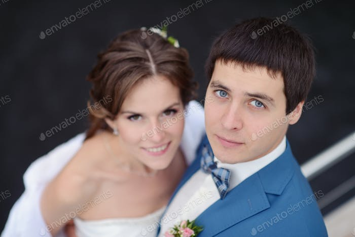 Wedding couple is hugging on a yacht