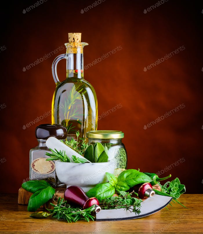Extra Virgin Olive Oil and Green Cooking Herbs