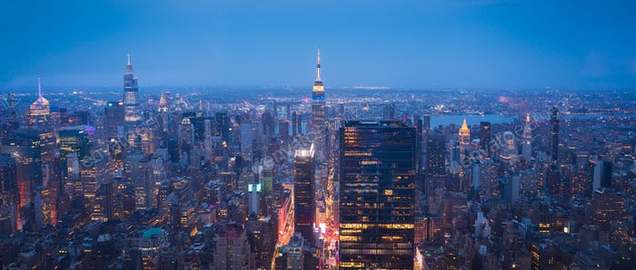 New York City Skyline with Urban Skyscrapers at Night Aerial View