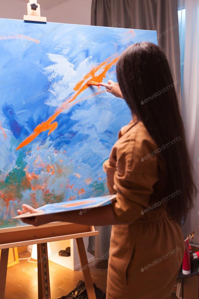 Successful artist in art studio