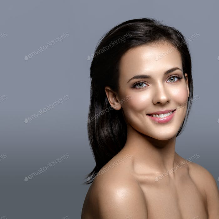 Beautiful girl with glowing skin