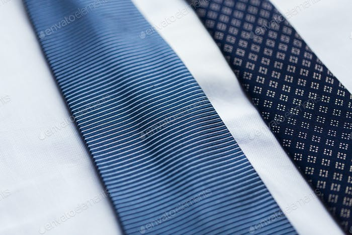close up of shirt and blue patterned ties