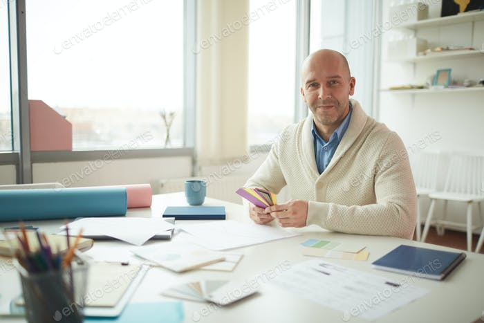 Mature Man Smiling at Workplace