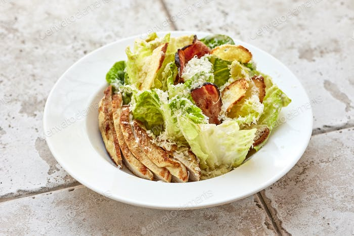 portion of cesar salad with chicken