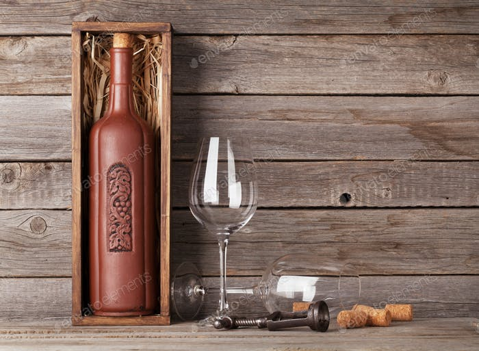 Wine bottle in box and glasses
