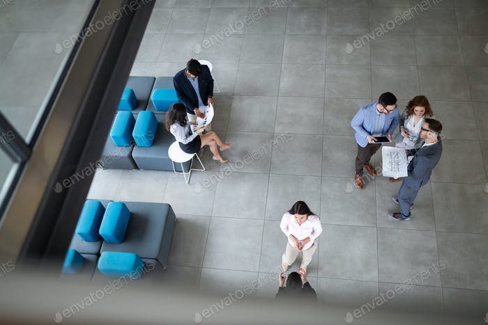 Group of lawyers discussing contract together in office
