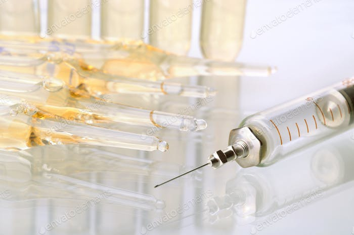 Vintage syringe and glass vials