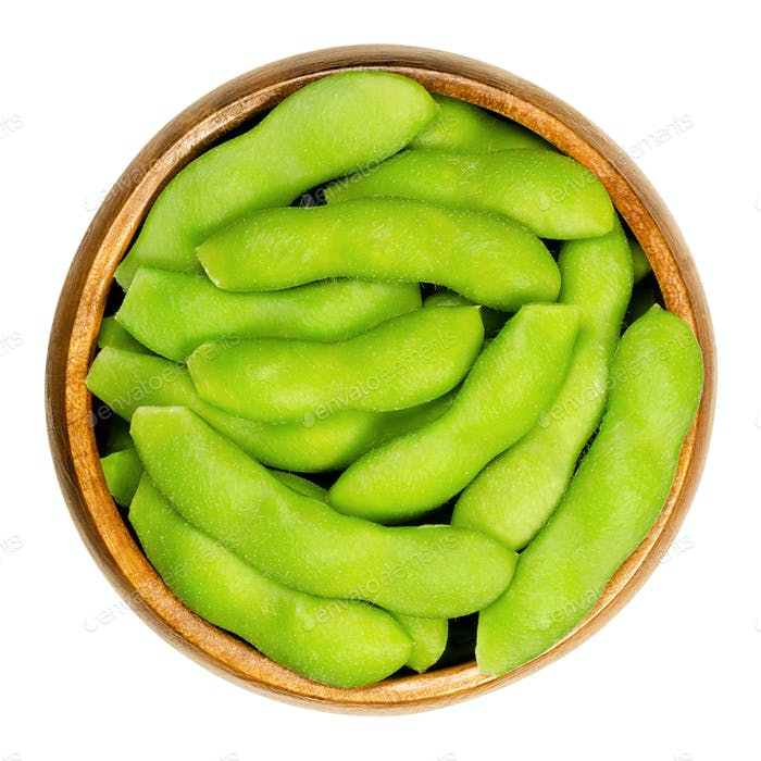 Edamame, green soybeans in the pod, in wooden bowl