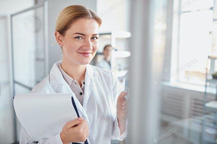 Smiling Female Medic in Laboratory