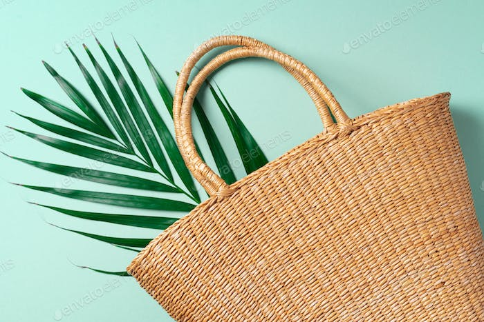 Handmade summer bag on trendy green background. Top view. Fashionable stylish accessory. Natural