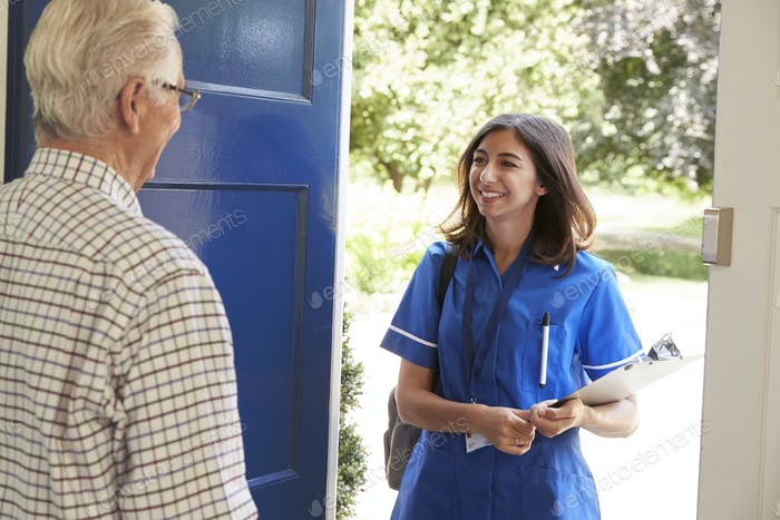 Senior man greeting female nurse making home visit