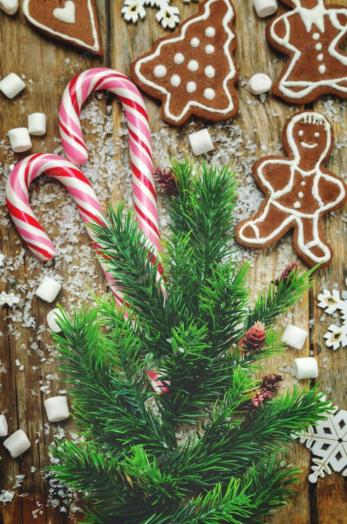 Wood dark background with Christmas tree, candies, cookies, mars