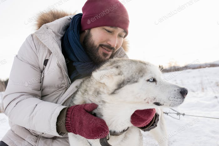 Asian Man with Gorgeous Dog