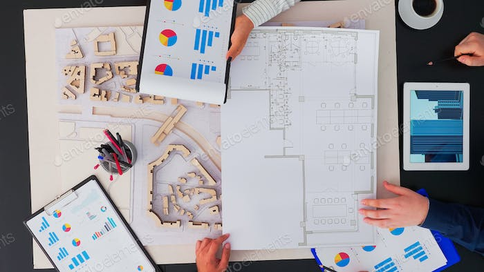 Architects working at office table