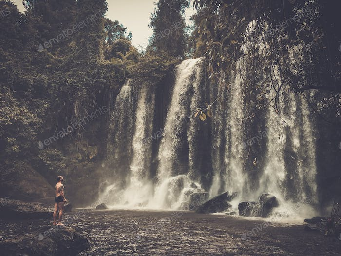 A man at the waterfall, Phnom Koulen at Siem Reap, Cambodia