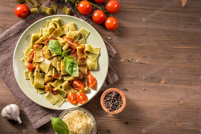 Italian pappardelle pasta with spinach on plate