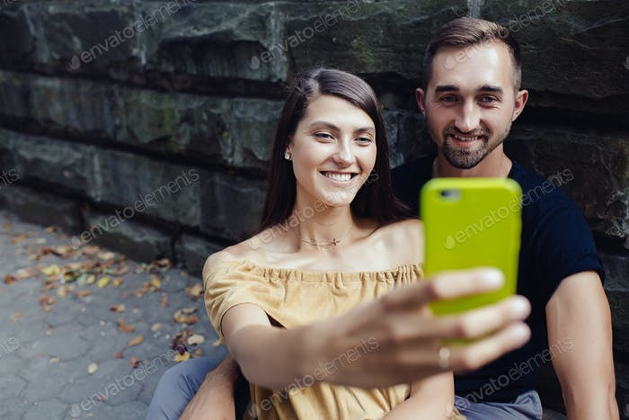 young beautiful couple make selfie