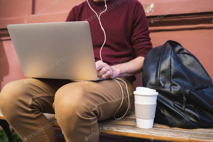 Young man using laptop.