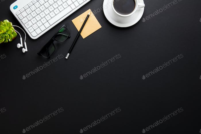 Keyboard With Coffee Cup And Office Supplies On Gray Desk