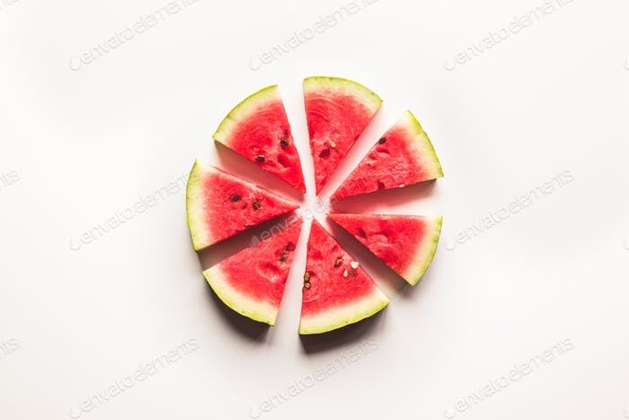 closeup of some pieces of refreshing watermelon on a white background. Wholesome healthy food