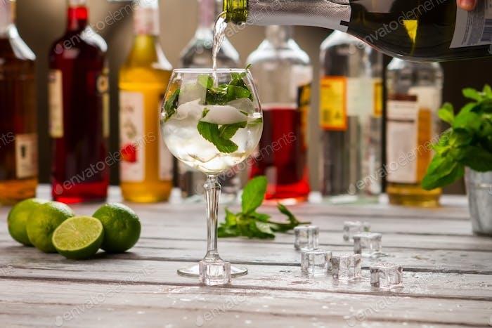 Bottle pours liquid in wineglass