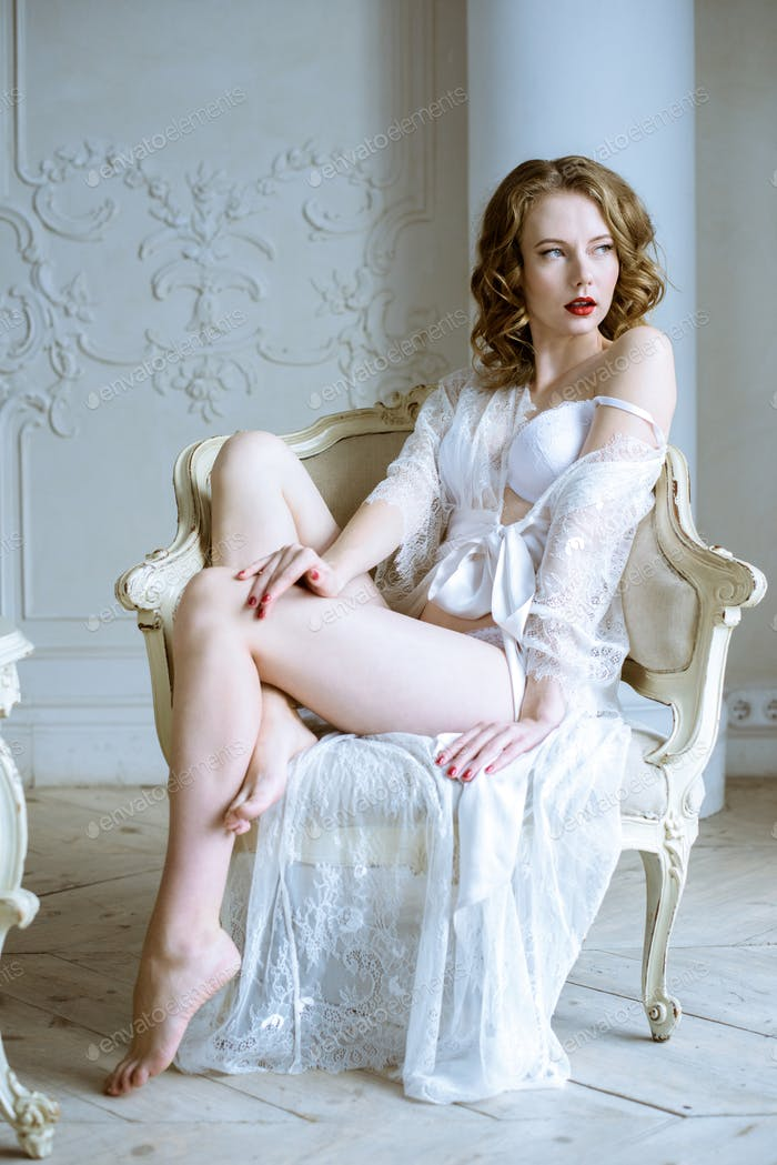 Beautiful sexy lady in elegant white robe