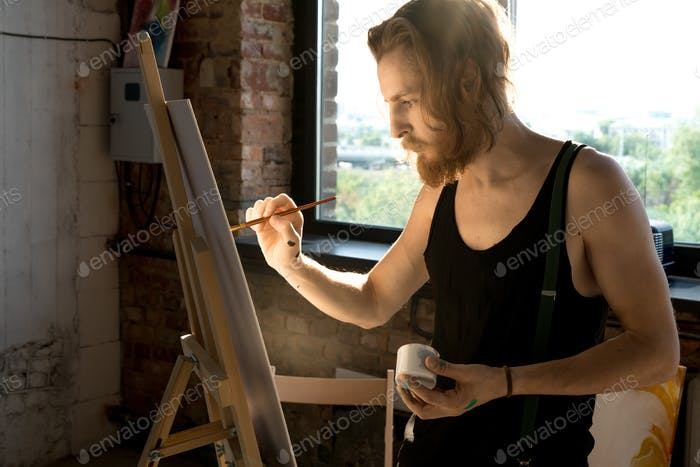 Bearded Artist Painting Picture in Sunlight