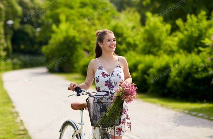 happy woman riding fixie bicycle in summer park