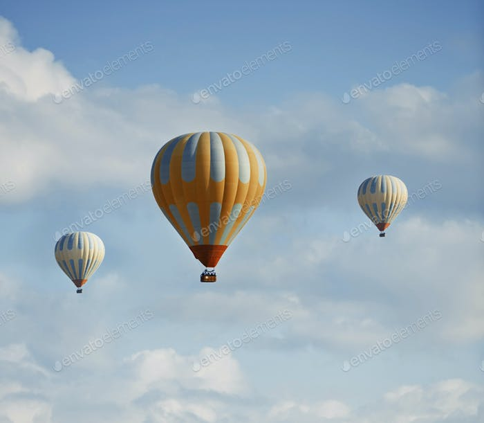 Three Hot Air Balloons Flying in the Sky