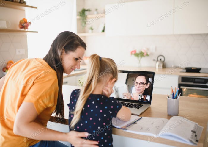 Small girl learning through internet indoors at home, Corona virus and quarantine concept