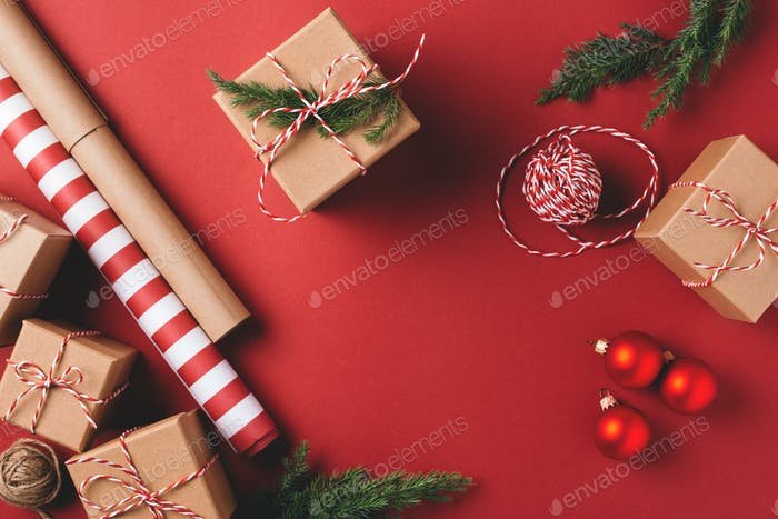 Christmas Background with Gifts and Decorations on Red.