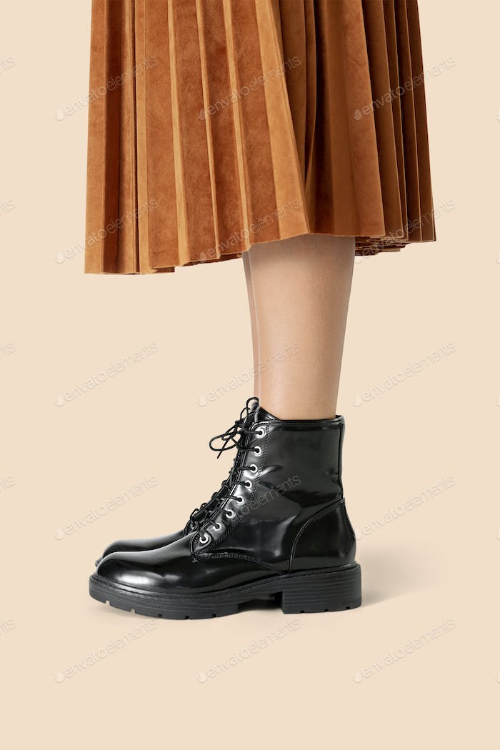 Woman in a skirt wearing combat boots