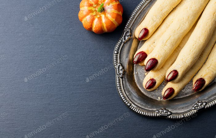 Cookies Witch's Fingers for Halloween Party Celebration. Slate Background. Copy Space. Top View.