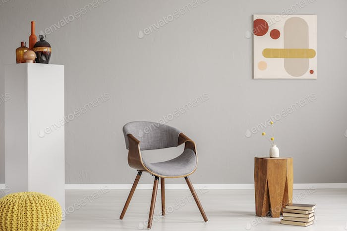 Trendy grey and wooden chair in retro living room interior
