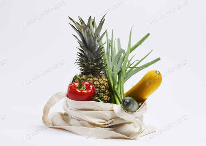 Reusable bag of eco vegetable and fruit on white background