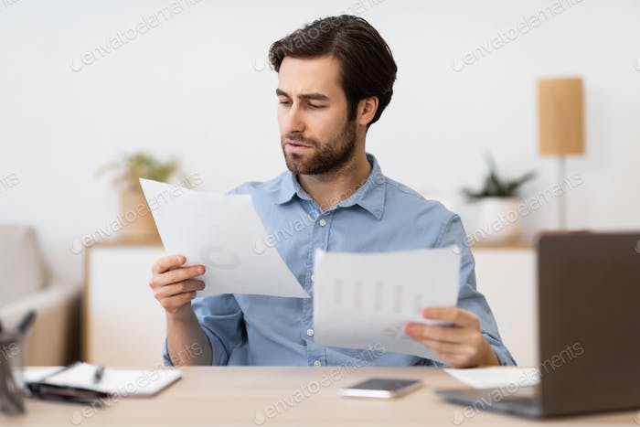 Serious Businessman Entrepreneur Reading Business Correspondence Working Sitting In Office