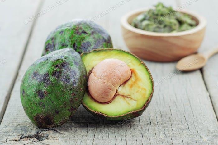Fresh avocado cut on wooden