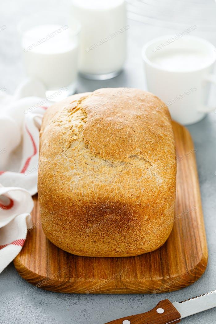Homemade white wholegrain bread sliced on wooden board