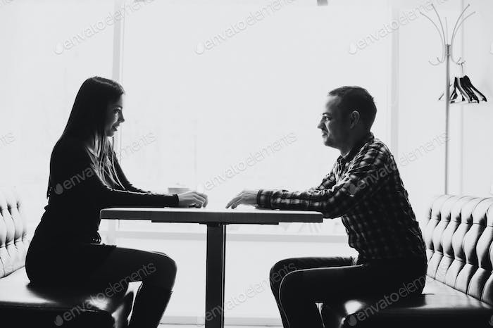 Man and woman in discussions in the restaurant