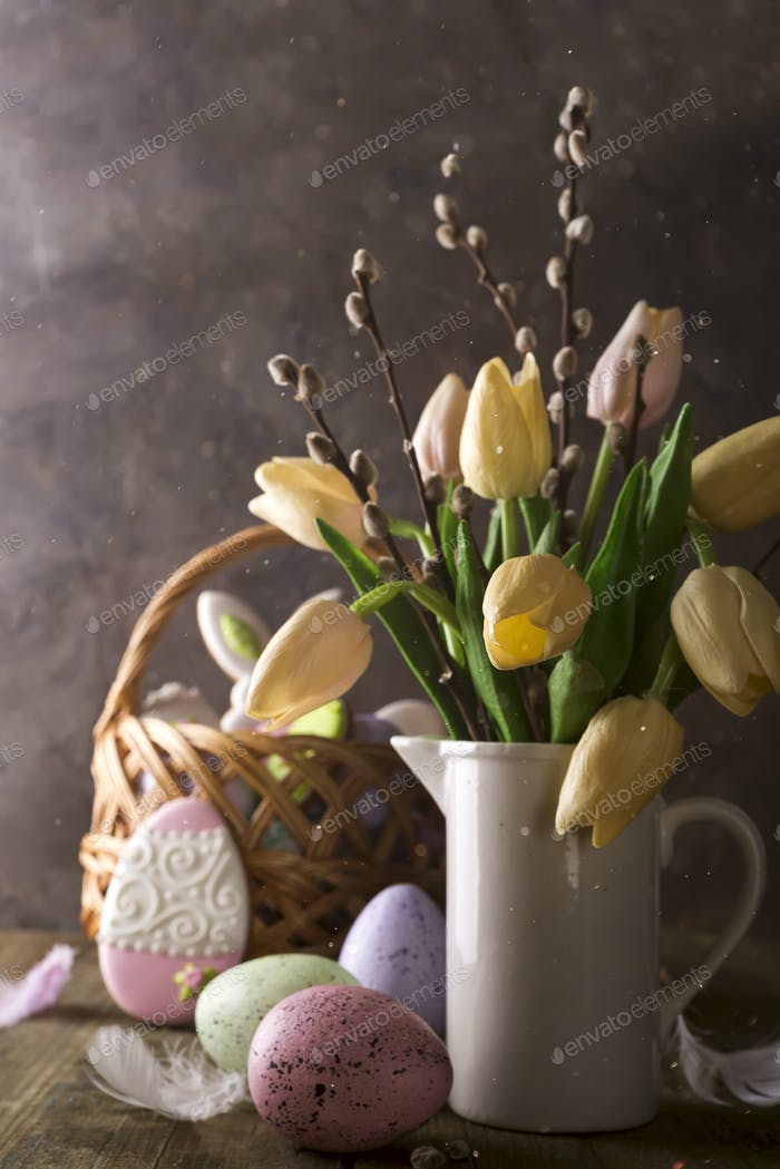spring tulips with easter eggs on rustic background