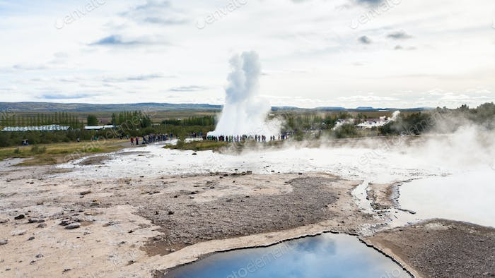 Strokkur geyser eruption and pool of Geysir