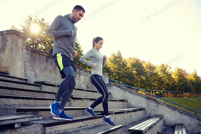 couple running downstairs on stadium