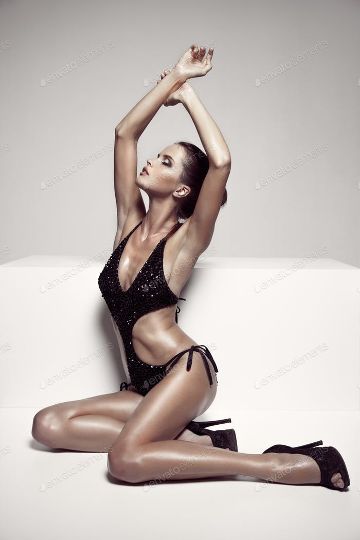 Beautiful Tan Female Model Posing In Bikini And Shoes.